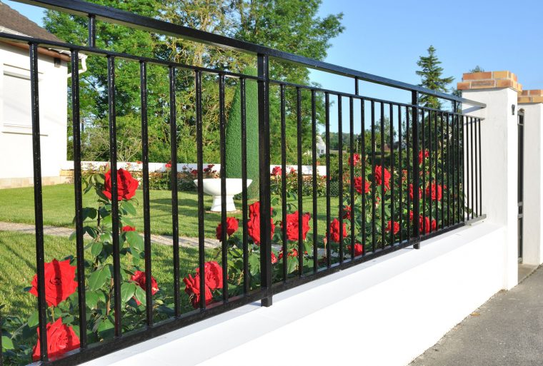 How to Make Your Fence Blend In With the Garden